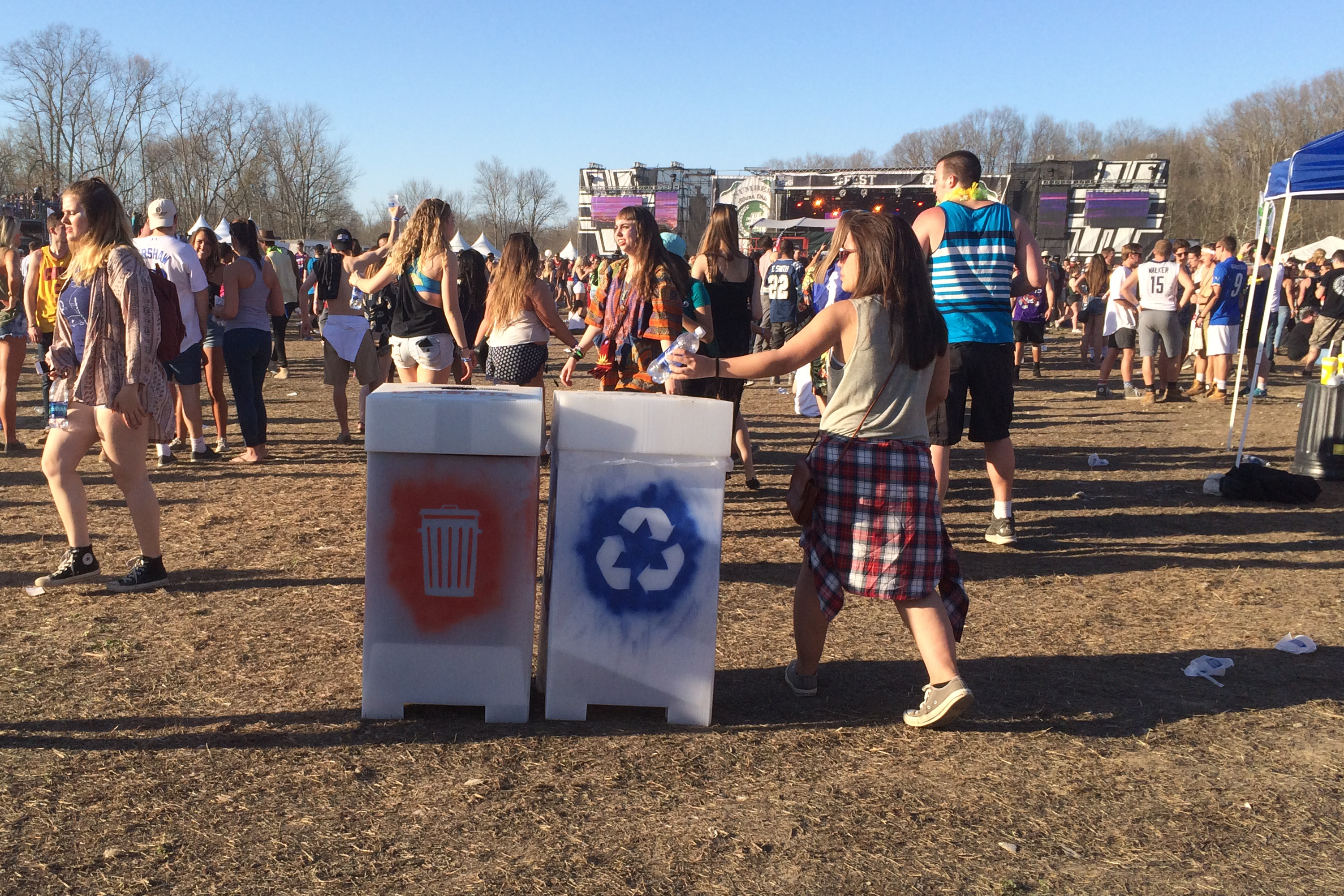 A young woman recycles her water bottle at #Fest 2016.