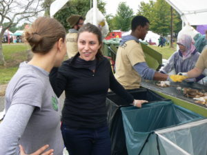 A Zero Waste Event Productions volunteer talks to a festival attendee about zero waste at The Ohio Pawpaw festival.