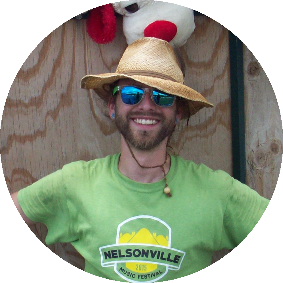 Zero Waste Event Productions Staff Picture of Tyler Bonner. Posing in front of the Compost Trail at Nelsonville Music Festival in 2015