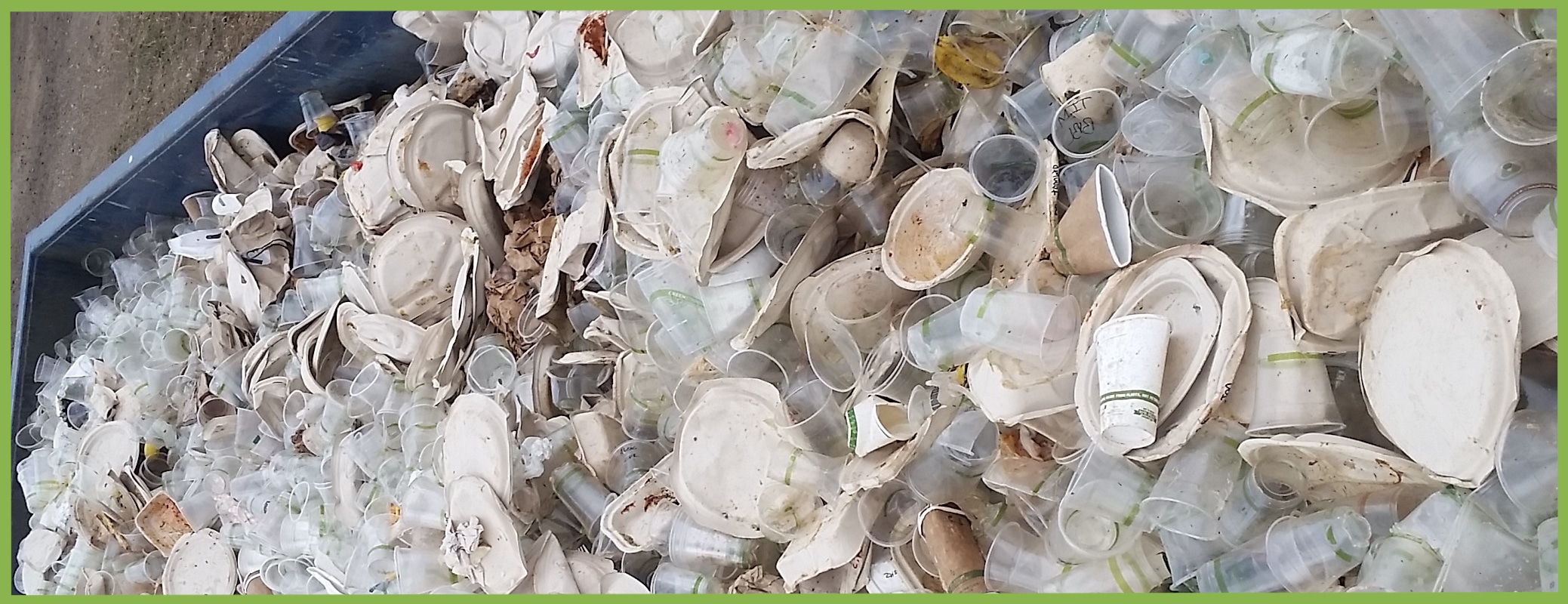 Dumpster full of compostable serviceware- paper, plastic and food scraps